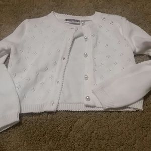 White cardigan sweater. Pearl buttons